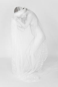 Figure and 1920's vintage bridal veil.